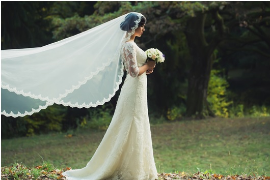 Temptations By Design England S Unique And Elegant Wedding And Bridal Wear,Lace Wedding Dress With Bow In Back